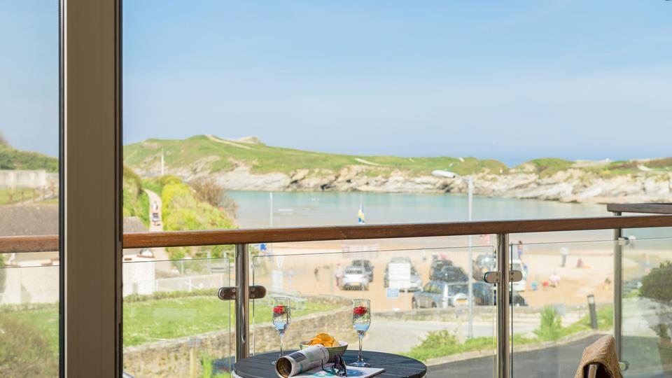 Doors open up from the living area to the balcony to enjoy stunning views of Porth beach.