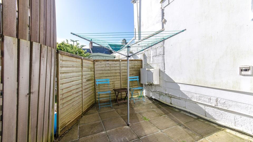 The outside area can be a real suntrap, there are two painted chairs and a small coffee table provided.