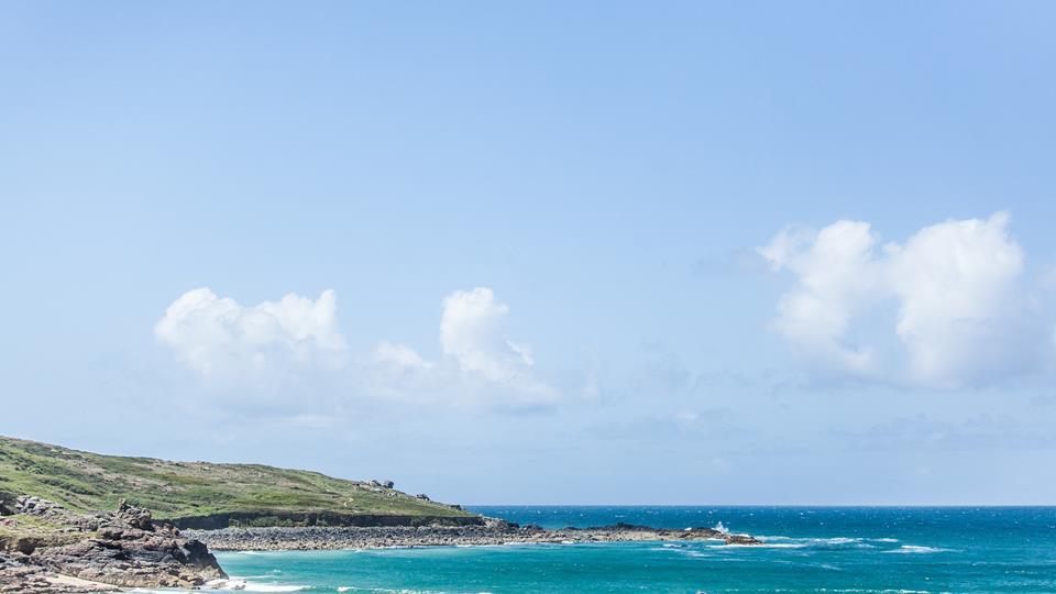 Porthmeor beach is a pretty bay with legendary blue sea, rugged coastline headland and soft light sand.