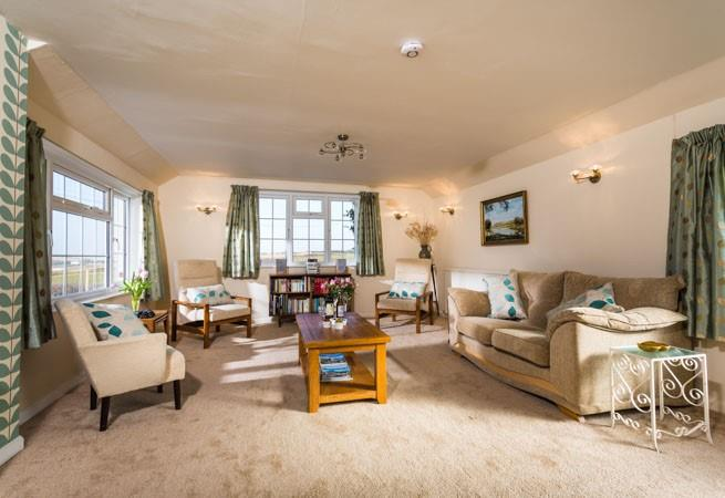 The Granary is all on the first floor, with cosy electric fire and lovely sea views of Crantock Bay.