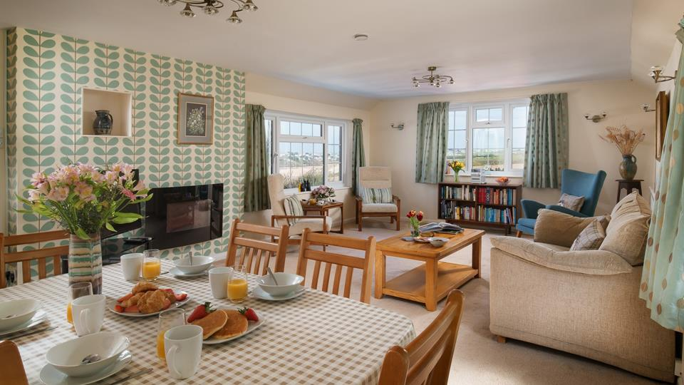 The open plan living/dining area creates a spacious environment, perfect for socialising or planning the day ahead!