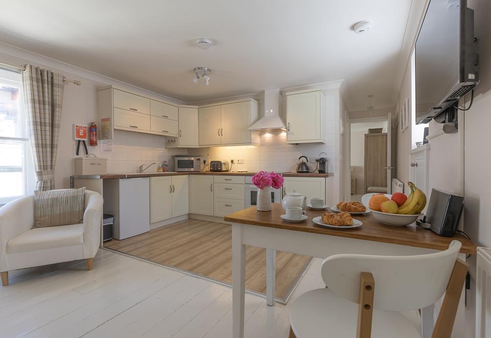 Open plan kitchen with modern appliances.