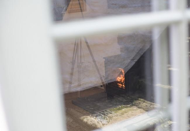 Looking into Abbey Cottage you can see the snug fire to keep you warm in the cooler months