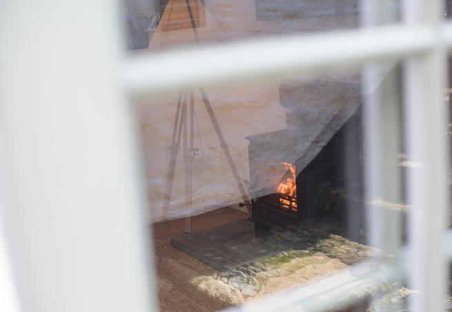 Looking into Abbey Cottage you can see the snug fire to keep you warm in the cooler months.