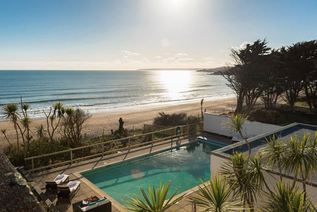Soak up some sun in the heated swimming pool, which overlooks the gorgeous sandy beach or Praa Sands.
