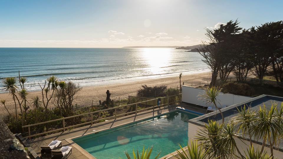 Soak up some sun in the heated swimming pool, which overlooks the gorgeous sandy beach.