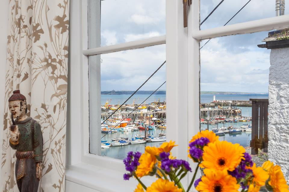 The Secret Cottage is tucked away in an elevated position, overlooking the pretty harbour.