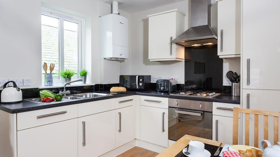 The kitchen is sleek and fully equipped with modern appliances, making it an absolute dream to cook in!