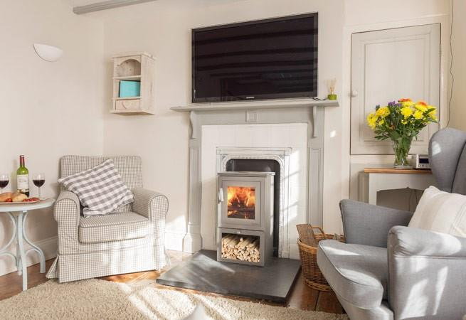 Sitting area with woodburner and TV.