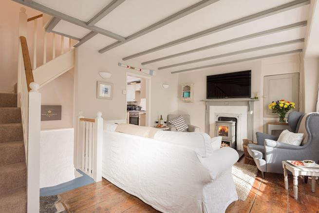 This quirky property, has stairs that lead from the sitting room down to the basement dining room and stairs leading to bedroom one on the first floor.