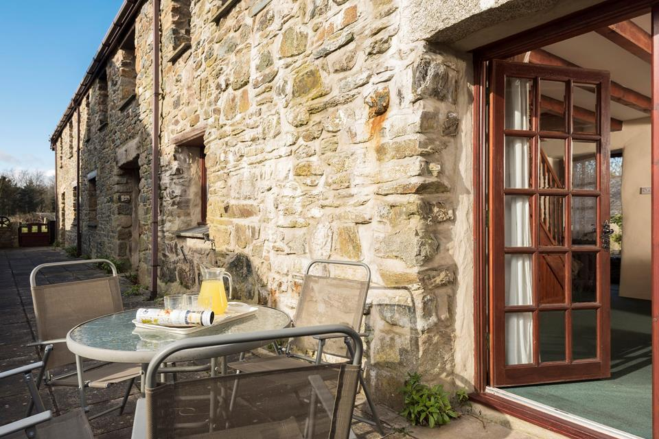 The patio area at the rear of the barns is accessed via the patio doors form the sitting room.