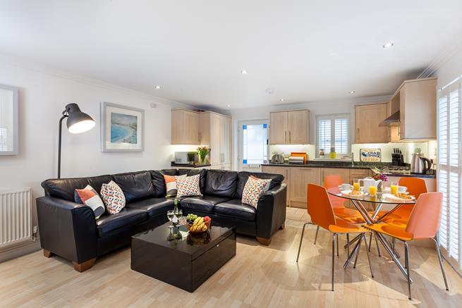 Open plan kitchen/dining/sitting room.
