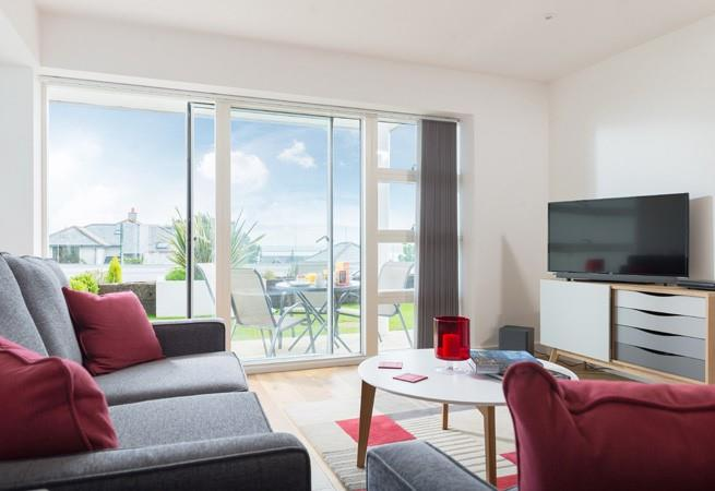Luxurious living area with two sofas, SMART TV/DVD, Netflix, Bluetooth sound bar and sea views