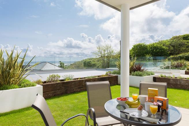 Enclosed garden area with table and seating for four plus wonderful sea views.