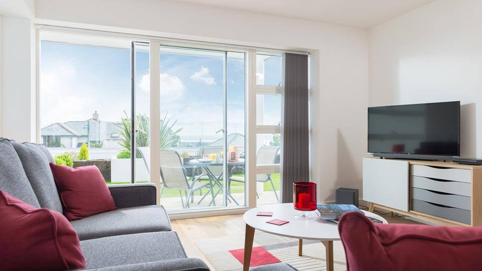 Luxurious living area with two sofas, SMART TV/DVD, Netflix, Bluetooth sound bar and sea views.