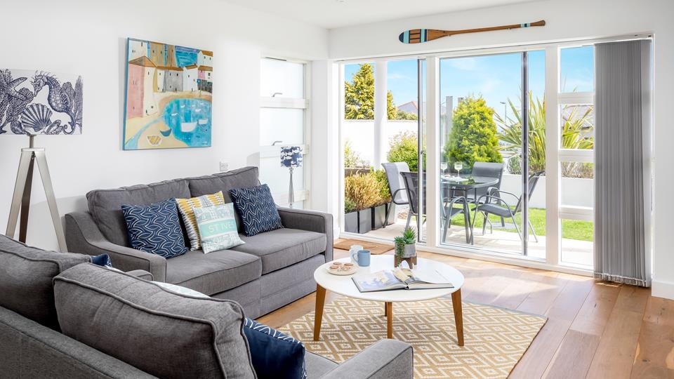 Open up the patio doors and relax in the sitting area, the fresh sea air drifting in.