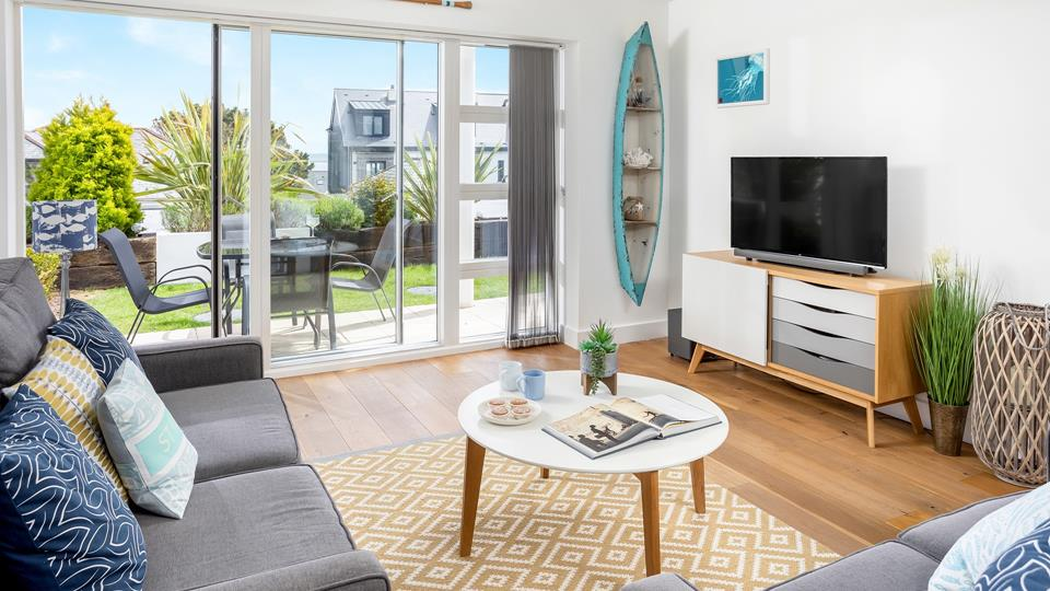 Bright and spacious, the living area is beautifully styled with coastal décor.