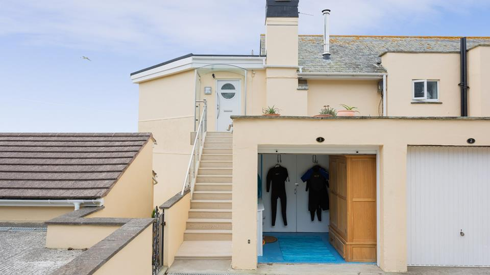 There are steps up to the front door and convenient wetsuit storage in the garage.
