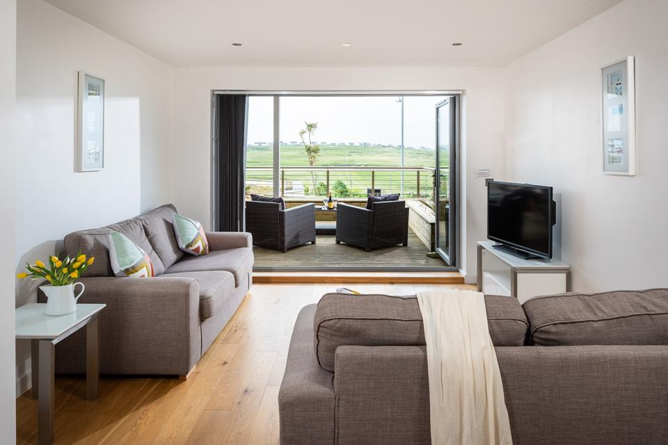 The open plan living area provides a comfortable space for relaxing after a day at the beach.
