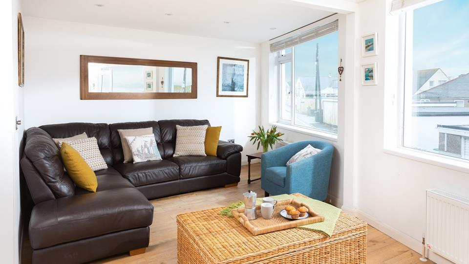 Modern and stylish the living space offers you a chance to relax after a day at the beach.