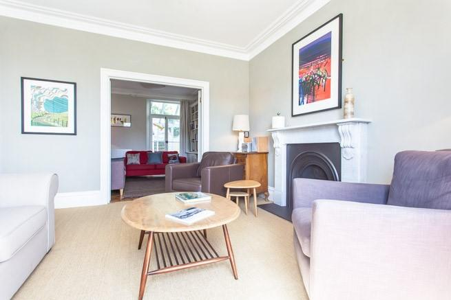 Adjoining sitting rooms with plenty of comfy seating.