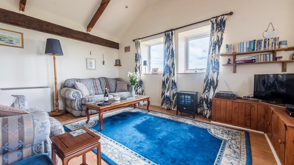 A spacious yet comfy living room to enjoy with breathtaking views of Sennen Cove lighthouse.