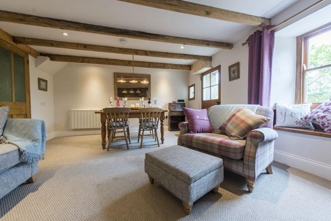 The combined sitting/dining room has a wood burning stove, making it a perfect  place to stay in the colder months as well as summer