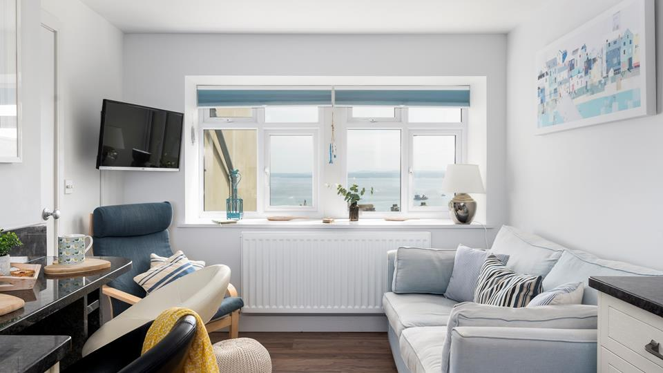 Decorated in dreamy cream and pastel shades, this is the perfect seaside retreat for couples or solo travellers.