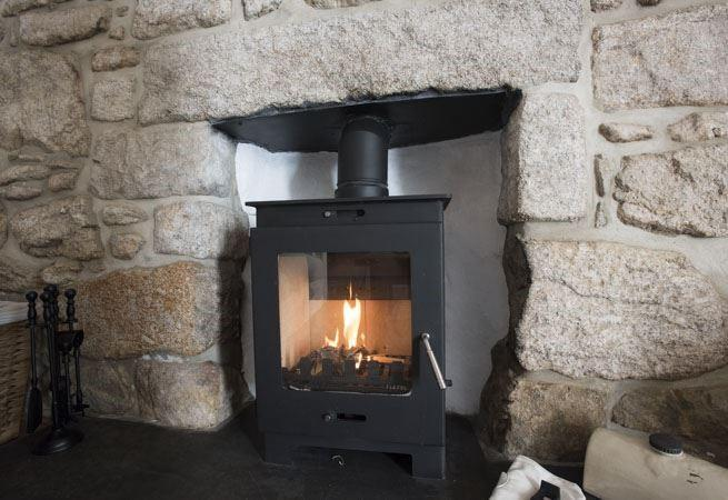 The wood burning stove will keep you warm and cosy whatever the season