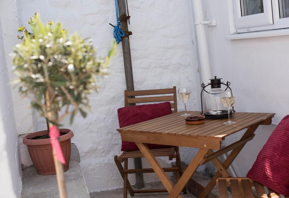 Enjoy a glass of wine outside.