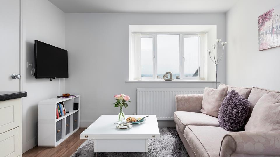 Blending a mixture of soft colours and snug textures, the living area is a haven of relaxation.