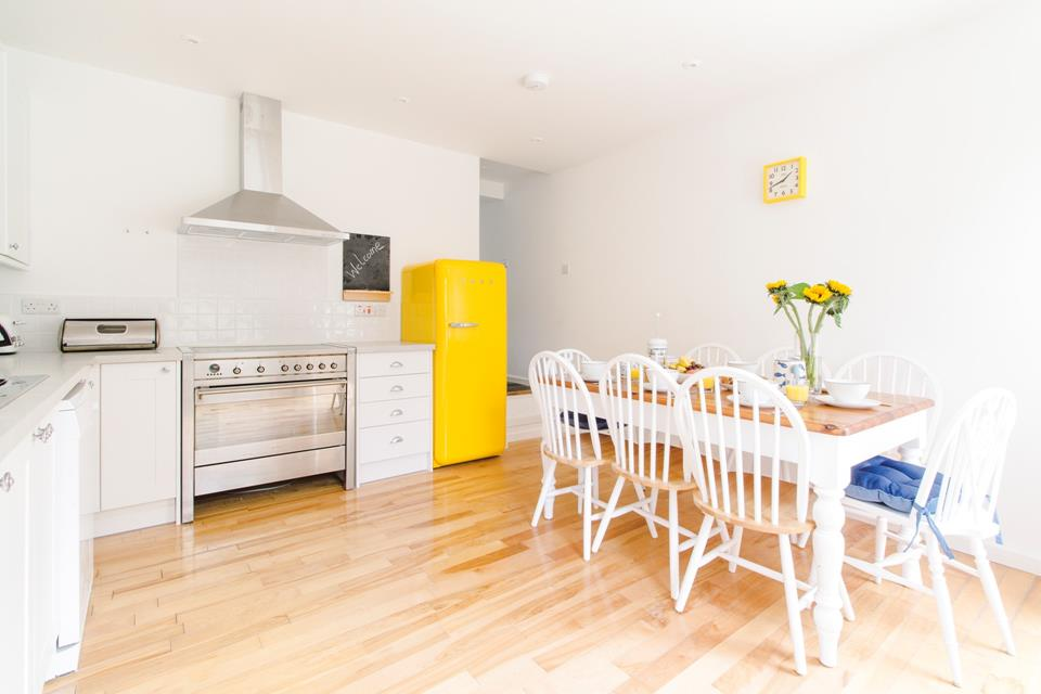 The light, airy modern well equipped kitchen.