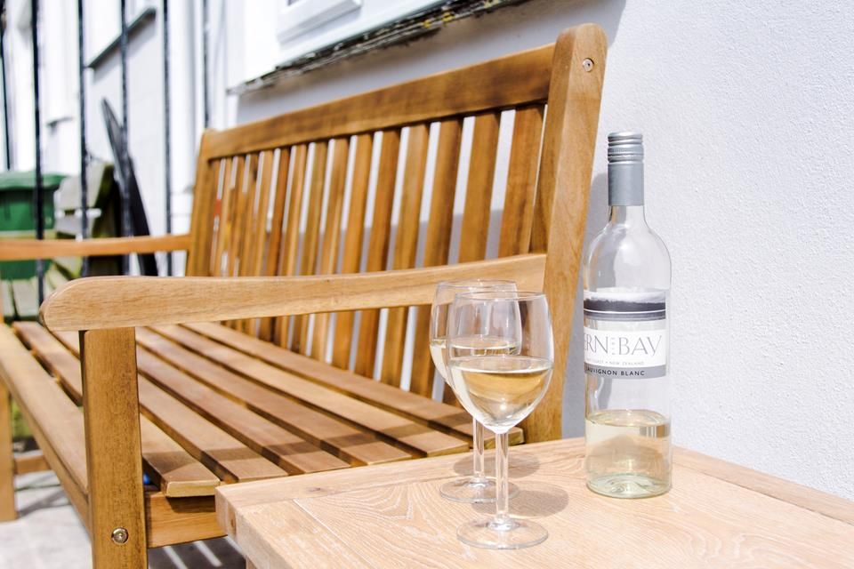 Sit and enjoy a drink on the bench in the shared courtyard.