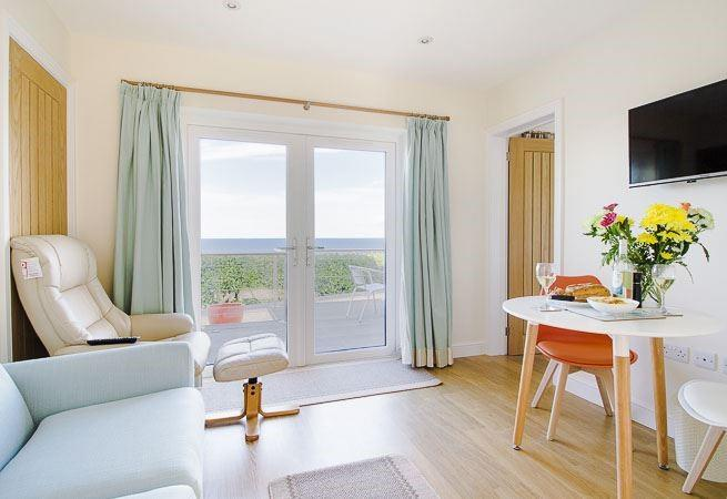 The sitting room has double doors leading to the terrace.