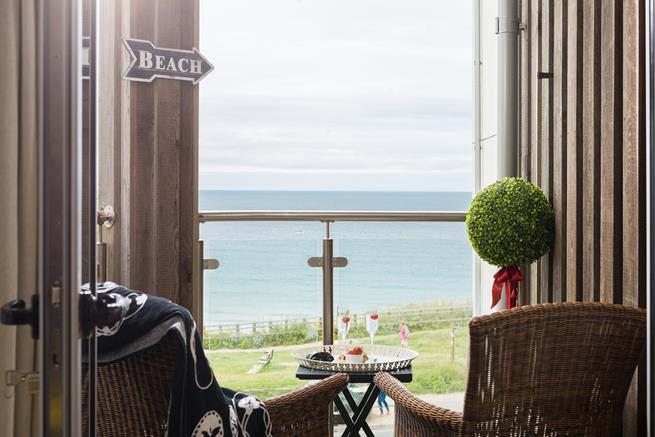 Sea views from the balcony where you can enjoy a glass of your favourite drink whilst watching the surf.