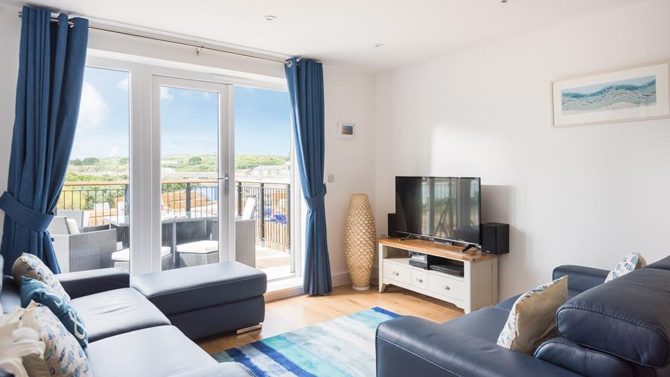The spacious family sitting room has stunning views across Hayle estuary.