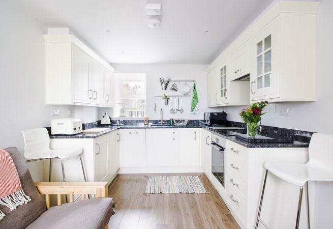 Beautifully presented open plan kitchen.