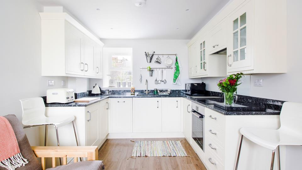 Beautifully presented open plan kitchen.