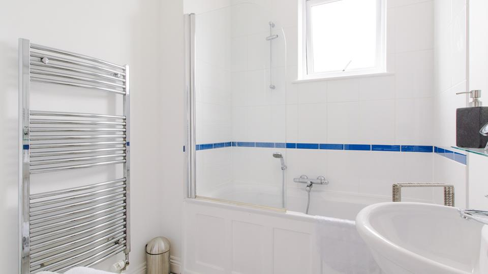 The main bathroom benefits from both a bath and shower over, perfect for washing the sand away after a day on one of St Ives golden beaches!