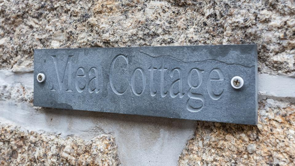 The local slate sign looks great against the granite stone-face walls.