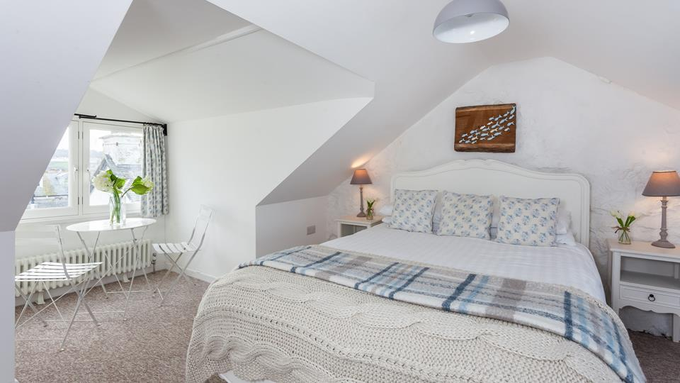Bedroom 3 has a double bed and dual aspect sea views.