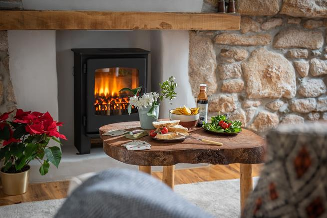 Enjoy a delicious snack together by the woodburner effect electric fire.