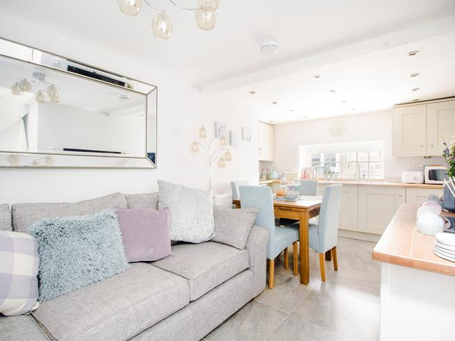The kitchen/dining /sitting room is beautifully decorated with a homely feel.