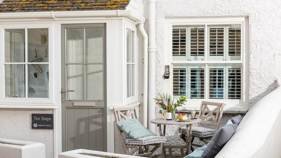 Enjoy a glass of wine in the little courtyard at the front of this lovely holiday home.