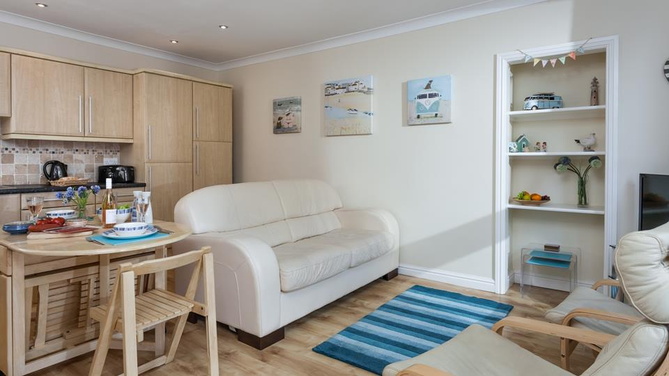 The open plan living area ensures the property feels bright and airy, ideal for unwinding in.