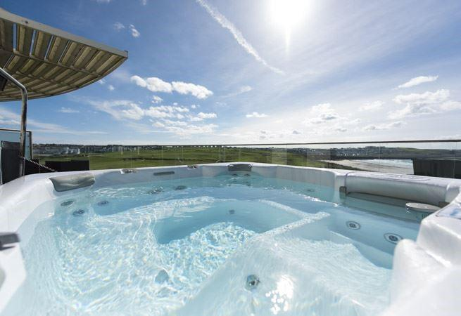 Relax with some bubbles in the hot tub on the top balcony.
