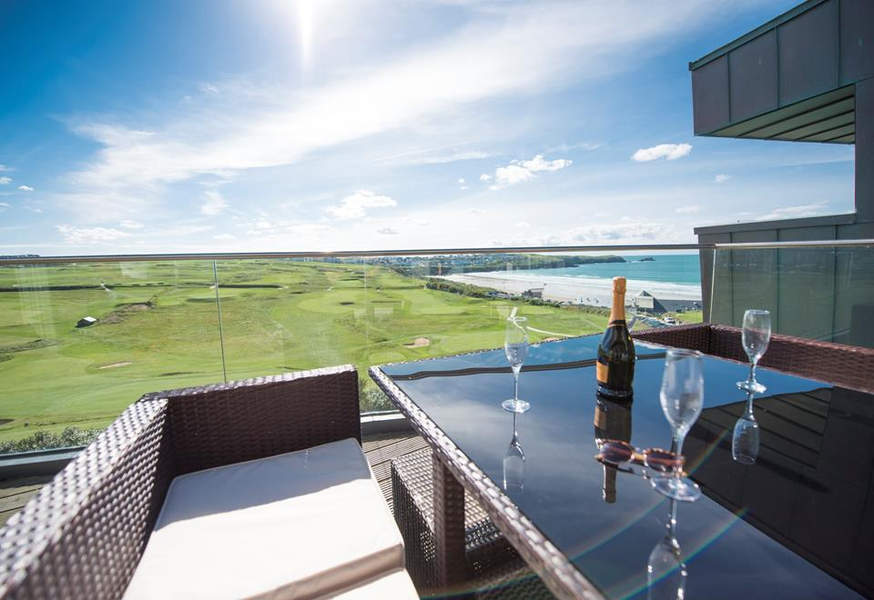 The balcony from the living area offers stunning views of Newquay golf course and the famous Fistral beach.