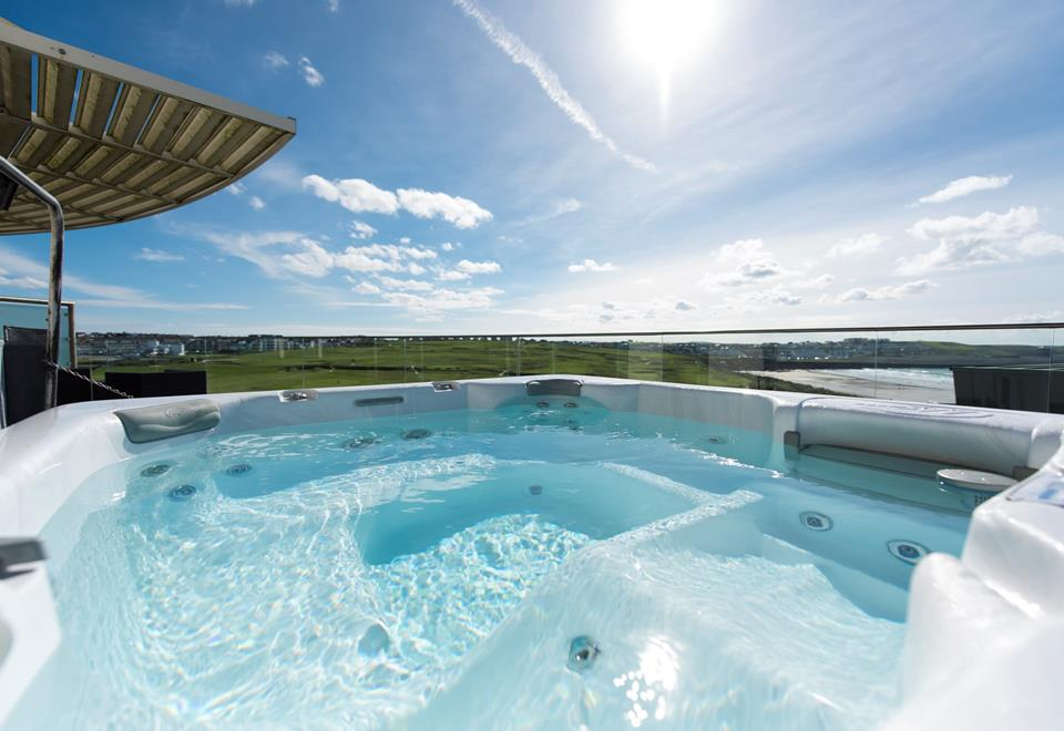 You can well and truly relax and soak aching muscles in the hot tub on the top balcony.