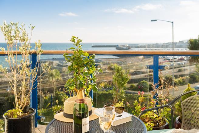 Balcony has stunning panoramic sea views.