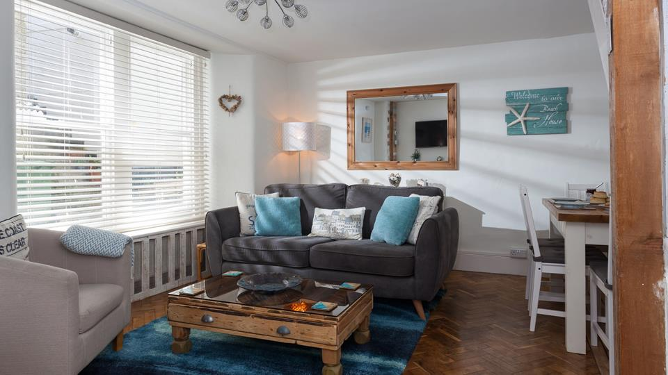 The living area offers ample room for the whole family to snuggle up and watch a film.